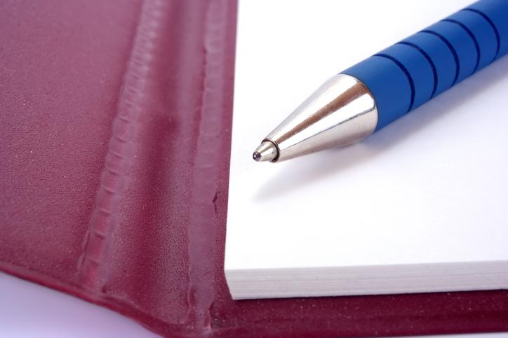 Pen lying on a notepad